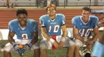 Zack Carroll (center), quarterback for Father Judge High School, takes a break with his teammates during a game this season.
