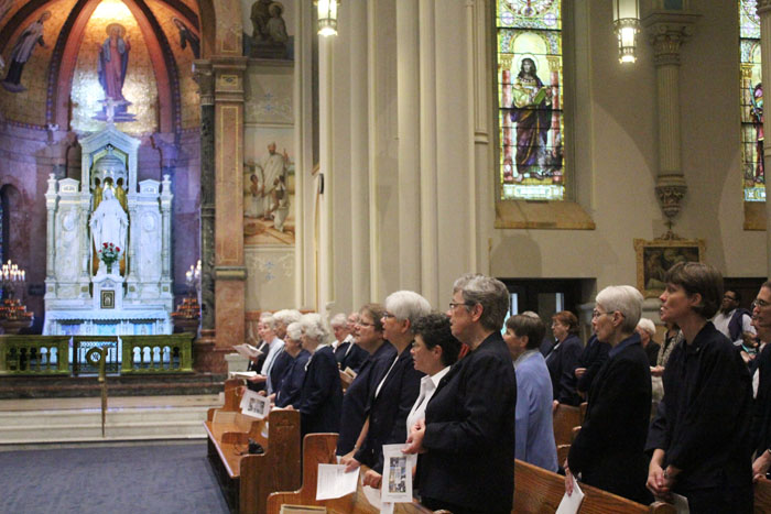Daughters of Charity sisters and many others pray in the Miraculous Medal Shrine Oct. 4 in Germantown, Philadelphia.