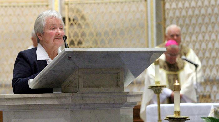 Sr Jean Maher serving at St Athanasius