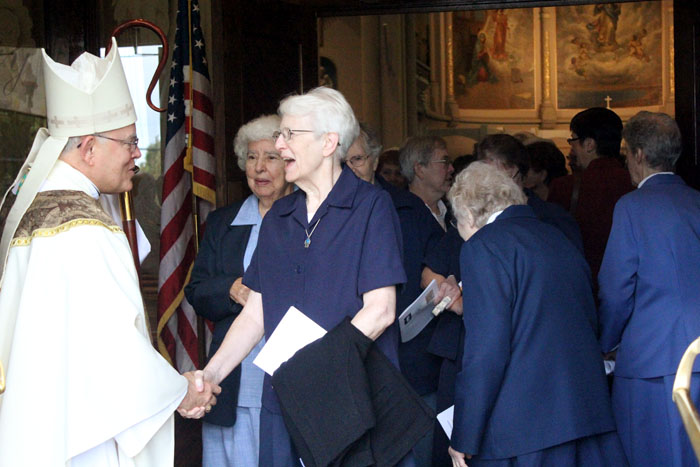 Archbishop Chaput greets sisters after mass