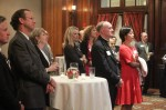 Bishop Michael Fitzgerald and other guests at the Union League watch a video presentation by Faith in the Future on the state of Catholic schools in the Philadelphia Archdiocese.