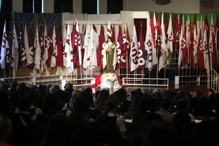 a flag to represent all 71 graduating classes were placed around the statue of St Terese