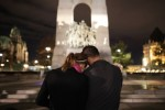 A couple embraces at the foot of the National War Memorial in Ottawa, Ontario, Oct. 23. Cpl. Nathan Cirillo, a Canadian soldier, was shot and killed the previous day while on duty at the nearby National War Memorial. (CNS photo/Cole Burston, EPA)