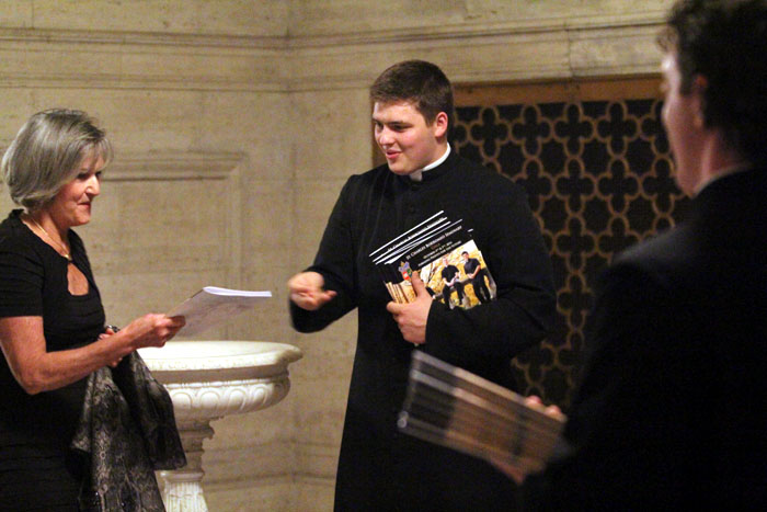 Seminarians greet guests as they enter St. Martin of Tours Chapel for the concert.