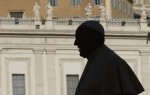 Pope Francis is silhouetted as he leaves his general audience in St. Peter's Square at the Vatican. (CNS photo/Paul Haring)