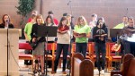 The St. Cyril youth choir sings and plays music to lead parishioners at Mass.