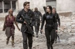 """Patina Miller, Liam Hemsworth, Mahershala Ali, Jennifer Lawrence and Elden Henson star in a scene from the movie """"'The Hunger Games: Mockingjay Part 1."""" (CNS photo/Lionsgate)"""