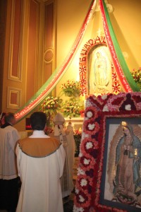 Archbishop Chaput blesses the cathedral's shrine to Our Lady of Guadalupe, decorated by the faithful for the occasion of the feast day.
