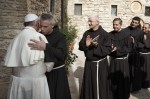 """U.S. Franciscan Father Michael Perry, minister general of the Order of Friars Minor, embraces Pope Francis during his 2013 visit to Assisi, Italy. Ineffective budgetary oversight and """"questionable"""" financial activities have plunged the Order of Friars Minor into significant debt and an extremely serious financial situation, Father Perry said. (CNS photo/Paul Haring)"""