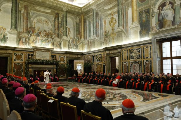 Pope Francis leads an audience to exchange Christmas greetings with members of the Roman Curia in Clementine Hall at the Vatican Dec. 22. (CNS photo/Paul Haring)
