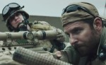 "Kyle Gallner and Bradley Cooper star in a scene from the movie ""American Sniper."" (CNS photo/Warner Bros.)"