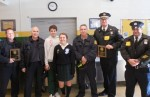 At St. Christopher School Jan. 28 are, from left: Philadelphia firefighters Perry Lawrynkiewicz and Paul Catto, Student Council Officers Michael Whalen and Colleen Dean, Fire Lieutenant Ralph Santiago (Engine 58), Police Captain Frank Bachmayer (7th District) and Sgt.Thomas Sileo.
