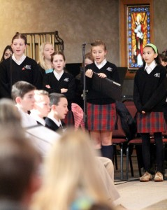 St Cornelius Youth Choir which includes the school children