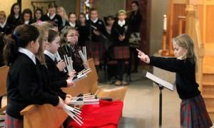 4th grader Ava Iannucci leads the bell choir