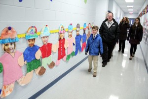 The Andrew family tours the school for CSW after the 11am mass