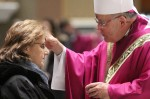 Archbishop Charles Chaput distributes ashes to Janis Malley of O