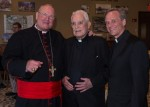 Holy Cross Father Theodore Hesburgh, center, is pictured in a 2013 photo with Cardinal Timothy M. Dolan of New York and Holy Cross Father John I. Jenkins, Notre Dame's president. (CNS photo/Sam Lucero, The Compass)
