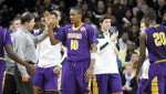 Roman Catholic standout guard Tony Carr (10) and teammates enjoy their slim lead over Neumann-Goretti during the Catholic League championship Feb. 23 at the Palestra, as Roman coach Chris McNesby (center, in gray) calls his players to the bench during a timeout. (Sarah Webb)