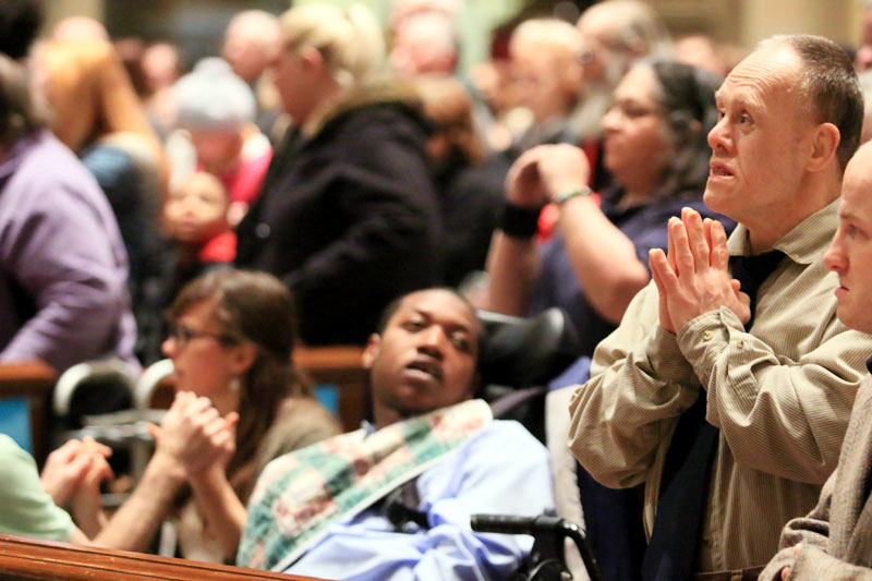 Jimmy from Don Guanella prays during mass AAAAAAAAAAAAAAAAAAAAAAAAAAAAAAAAAAAAAAAAAAAAAAAAAAAAAAAAAAAAAAAAAAAAAAAAAAAAAA
