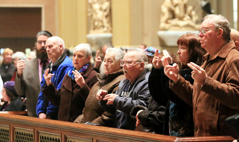 Members of the deaf community sign along during mass AAAAAAAAAAAAAAAAAAAAAAAAAAAAAAAAAAAAAAAAAAAAAAAAAAAAAAAAAAAAAAAAAAAAAAAAAAAAAA