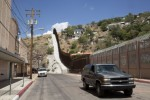 A border fence separates the sister cities of Nogales. On the left sits Nogales, Ariz., on the right is Nogales, in the Mexican state of Sonora. Pope Francis has erected the new Diocese of Nogales in northern Mexico, the Vatican announced March 19. (CNS/Nancy Wiechec)