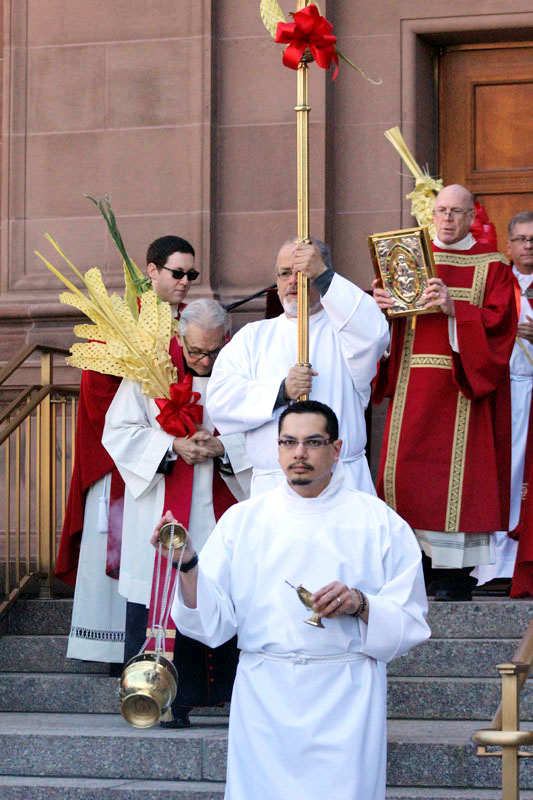Thurefer Adam Erdosy leads the procession from the steps of the chapel in to the Cathedral.