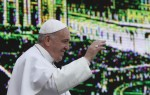 Pope Francis passes a video monitor as he arrives to lead his general audience in St. Peter's Square at the Vatican March 4. (CNS photo/Paul Haring)