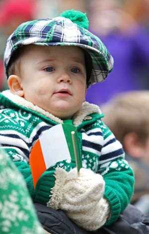 Two-year-old Walter Gilroy Jr. of Massapequa, N.Y., holds the flag of Ireland as he watches the 254th annual St. Patrick's Day Parade in New York City March 17. (CNS photo/Gregory A. Shemitz)
