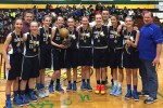 After winning the archdiocesan girls' CYO championship, the team poses for a photo including (from left) Maria D'Aulerio, Tara McGuigan, Bailey Vetter, Olivia Boyle, Cami Polinsky, Kate Mix, Belle Spinelli, Dana Bandurick, Lauren Vesey and (back row, from left) coaches Jim Staudt, John Coleman and Greg Gerber. Teammates not shown are Jessie Buten and Anna Needle.