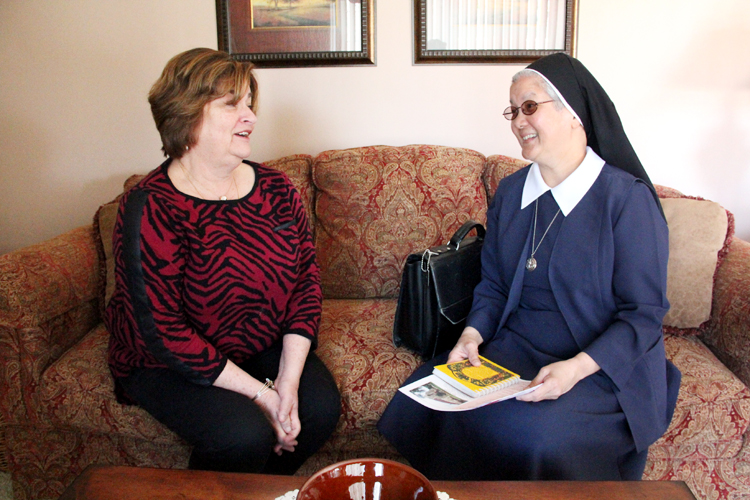 Susan Camp and Sister  Mary Praxedes chat in Camp's Torresdale home. (Sarah Webb)