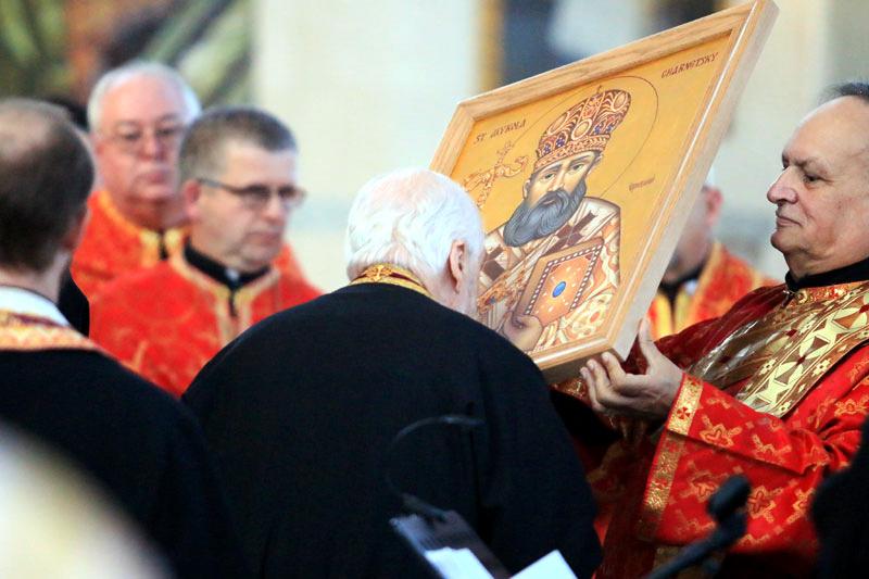 Ukrainian Catholic clergymen venerate the relic of Blessed Mykola Charnetsky.