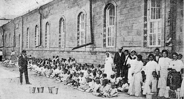 Armenian children left orphans by the massacres that reached their peak in 1915, yet continued for years after, sit for a photograph in this photo from the Archdiocese of Philadelphia's archives. (Philadelphia Archdiocesan Historical Research Center)
