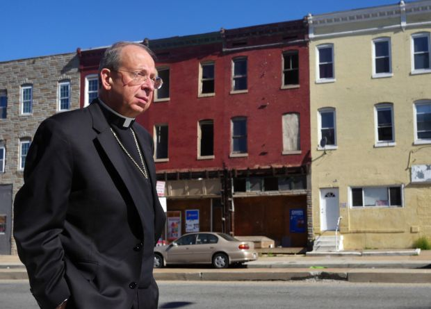 Baltimore Archbishop William E. Lori visits a riot-stricken section of West Baltimore April 28. During a night of unrest that erupted in response to the death of 25-year-old Freddie Gray while in police custody the archbishop called pastors to check on their safety and the situation in their neighborhoods. (CNS photo/Olivia Obineme, Catholic Review)