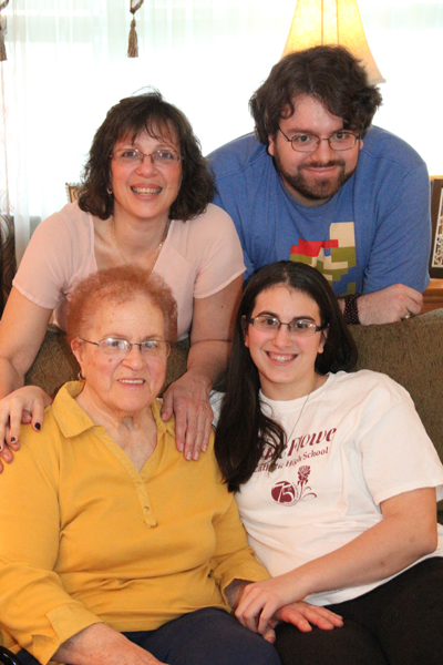The family, (seated from left) includes matriarch Josephine DeLuca, her granddaughter Juliana Bernaudo, (standing from left) mom Joanne Bernaudo and her son Dominic. (Sarah Webb)