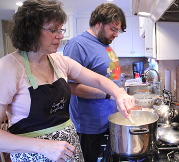 Joanne cooks dinner, which features her mother's gnocchi, with the help of son Dominic. (Sarah Webb)