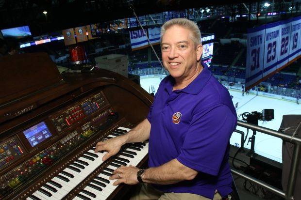 Paul Cartier, organist for the National Hockey League's New York Islanders, poses for a photo before a game at Nassau Veterans Memorial Coliseum in Uniondale, N.Y., March 26. Cartier also plays the organ for Major League Baseball's New York Yankees and at Our Lady of Hope Church in Carle Place, N.Y. (CNS photo/Gregory A. Shemitz)