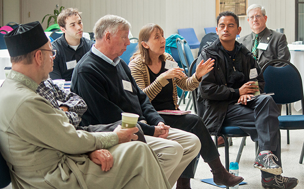 Participants discuss environmental concerns from faith perspectives at a conference April 17 at Cabrini College, Radnor.  Keynote speaker John Burke, a Cabrini professor, is at far right. (Photos by Ashley Block)