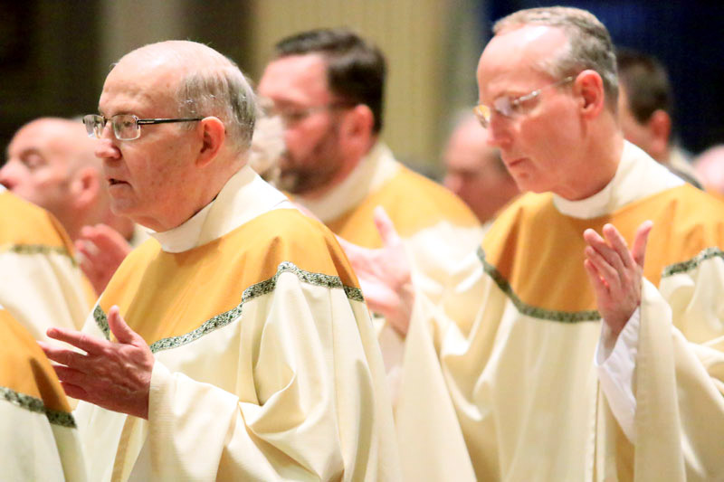 Fr Joseph Quindlen and Fr Jon Gabin pray the Lord's Prayer