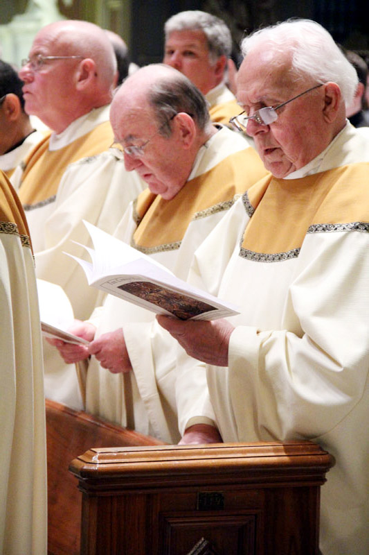 Msgr. David Diamond, Msgr. Phillip Ricci sing along to the opening song