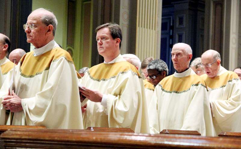 Msgr. Richard Bolger, Fr. Keith Chylinski, Msgr. James McBride, Fr. Joseph Quindlen renew their priestly promise