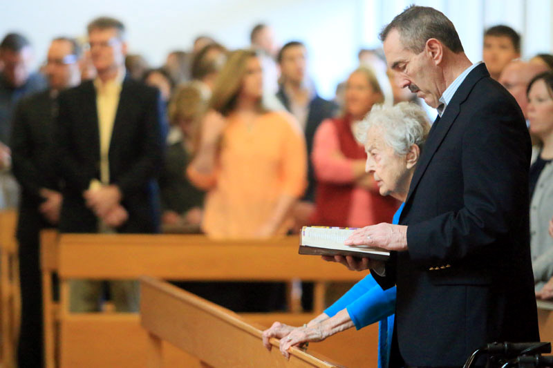Keith Holland attends mass for the second time on Easter so he can be with his mom Rita (Holland)