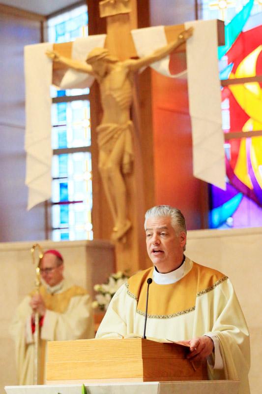 Fr Stephen Leva reads the gospel