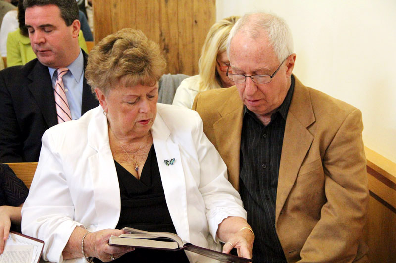 Sharon and John Dewald pray the World Meeting of Families prayer before mass