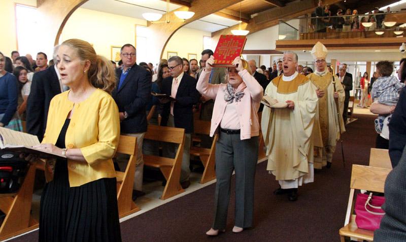 Lectors Julia Goolerud and Judy Olshin, Fr. Stephen Leva and Bishop Timothy Senior