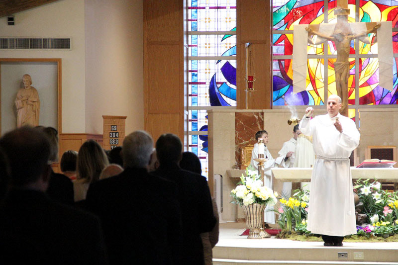 Diaconate student (Acolyte) John Mischler incensces the community
