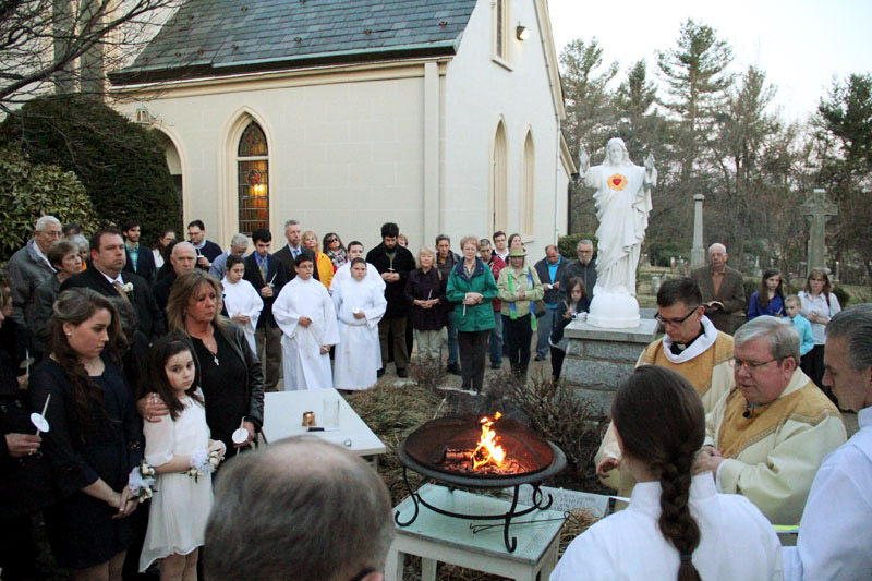 Mass starts in the courtyard with the lighting of the candle by Fr James Lyons (beside him is Fr Richard McGowan SJ from Boston College who is a son of the parish)