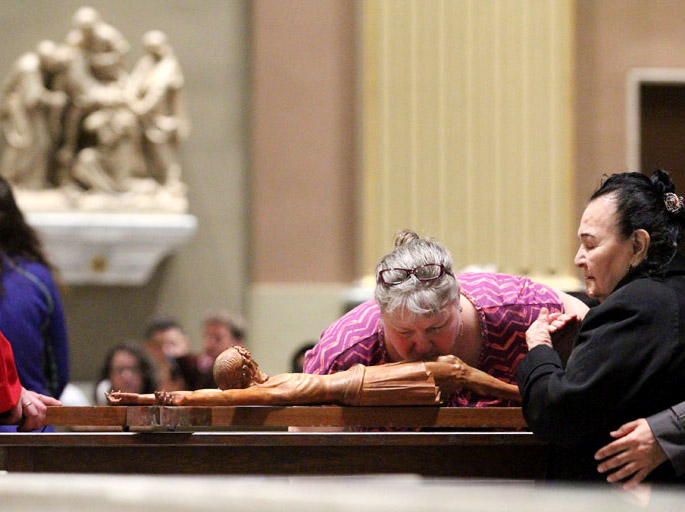 Karen Harvey vernerates the cross