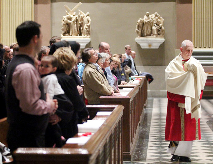 Transitional Deacon James Cordosi transfers the eucharist from the chapel to the main church