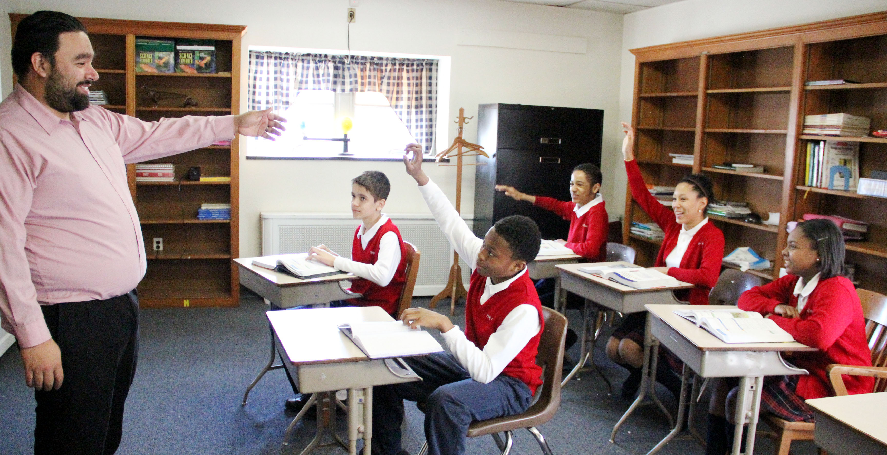 Charles Arroyave (left) teaches Sophia Program students Christopher Peralta, Jarod Thompson, Carl Whittington, Marleen Winterdal, Kaiya Austin April 13 at Holy Cross School in Philadelphia's Mount Airy section. (Sarah Webb)
