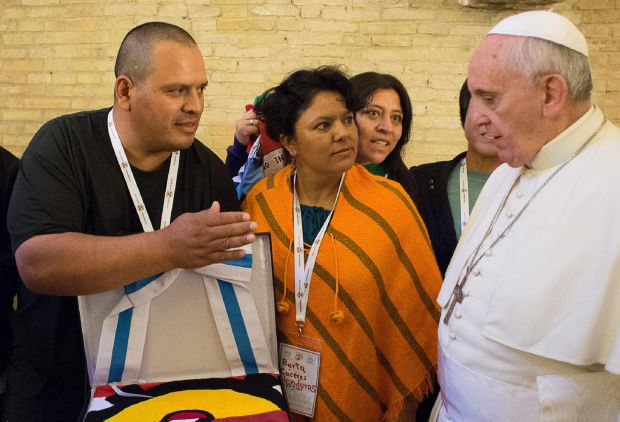 Berta Caceres, center, a Honduran indigenous rights activist, looks toward Pope Francis during the pope's meeting with grassroots social activists at the Vatican Oct. 28, 2014. (CNS photo/L'Osservatore Romano)
